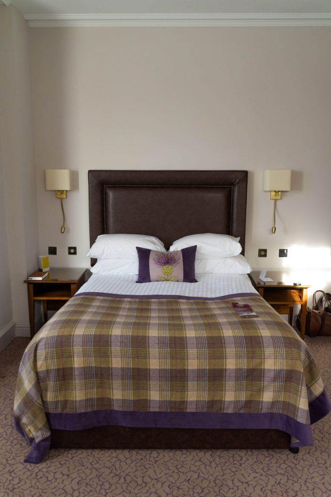 Bed in room at Macdonald Inchyra